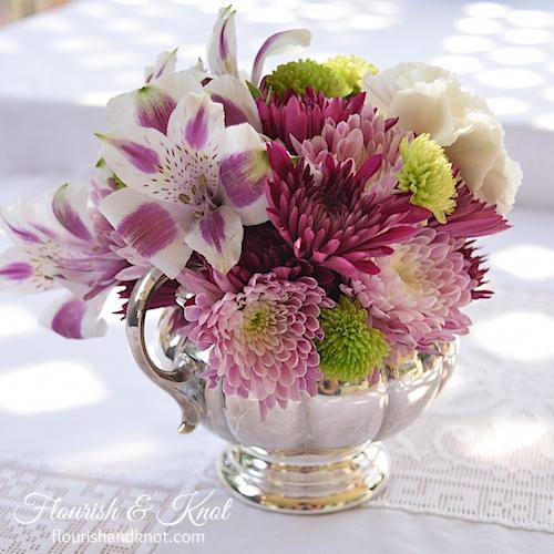 Purple, white, and green DIY arrangement in a silver creamer | flourishandknot.com