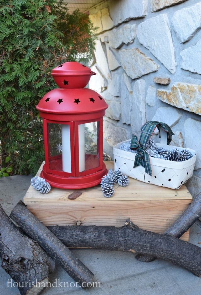 Flourish & Knot's 2015 Christmas Home Tour | flourishandknot.com | Big red lantern on a wooden box with pinecone and log details